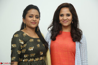 Actress Suma in Black Salwar Suit and Anusuya in orange Dress at winner movie press meet part 1 February 2017 (30).JPG