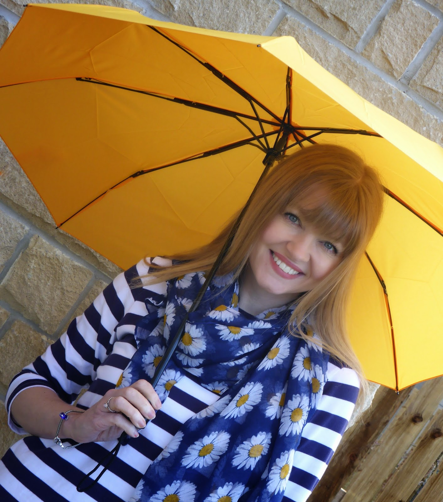Over 40 blogger What Lizzy Loves wearing Jack Wills Alburgh breton with floral scarf and yellow umbrella