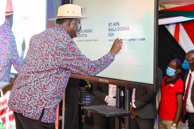 ODM boss Raila Odinga with President Uhuru Kenyatta on signature collection