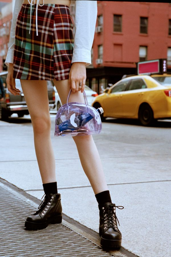 girl in plaid Urban outfitters mini skirt