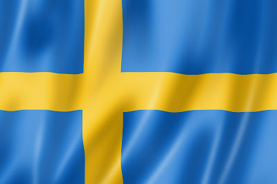 Pic of full screen shot of yellow cross on blue background of Swedish flag