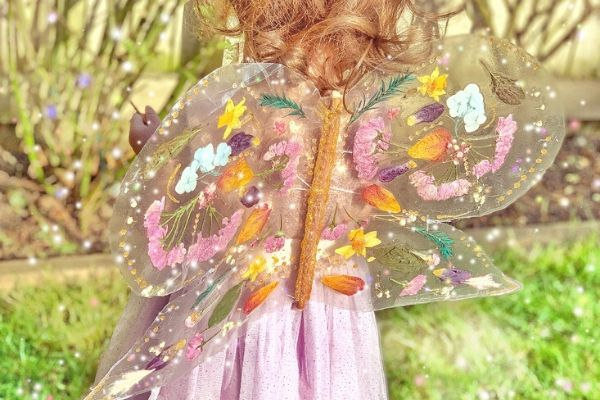 transparent fairy butterfly wings made with tacky back plastic and pressed flowers