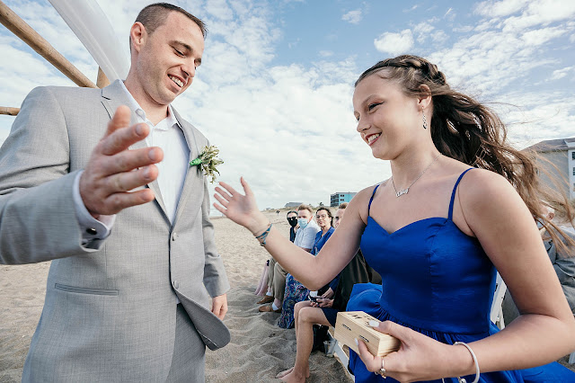 Groom high fiving Bridesmaid on entrance into ceremony