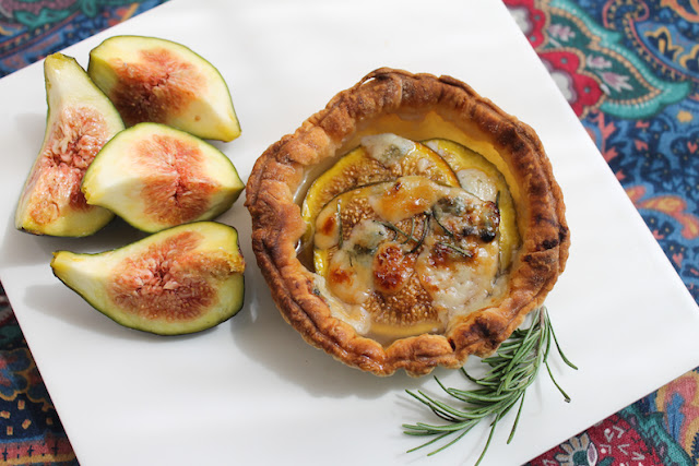 Food Lust People Love: Flakey buttery puff pastry is the perfect crust for these fresh fig blue cheese tarts with rosemary and honey. Crunchy, sweet and salty, these little tarts are one of my favorite recipes to make with fresh figs. Serve these tarts as a main course, with a lovely salad of greens tossed with a sharp vinaigrette dressing.