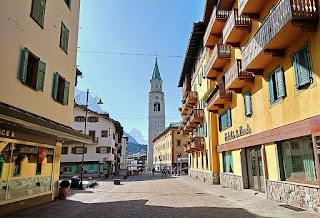 The Corso Italia in Cortina d'Ampezzo, looking towards  the bell tower of Santi Filippo e Giacomo Apostoli