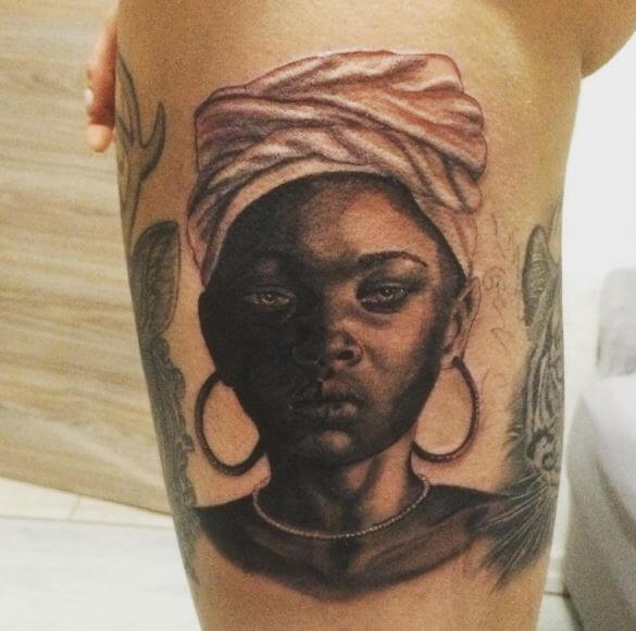ac0472a03 It is hard to make a portrait tattoo and that too on the calf. Here is an  amazing tattoo of an African girl.