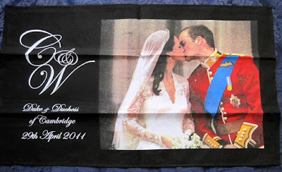 https://timewasantiques.net/collections/prince-william-and-catherine-will-and-kate-children/products/william-catherine-royal-wedding-balcony-kiss-tea-towel-royal-kiss-dish-towel-2011