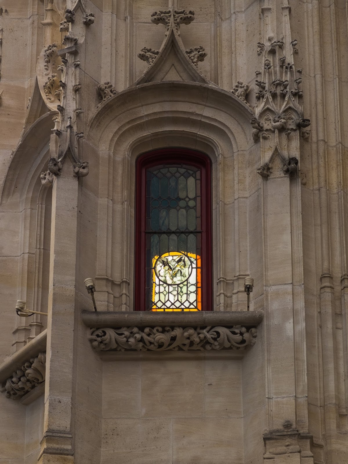 A red window in a tower in Rouen, Normandy, France.
