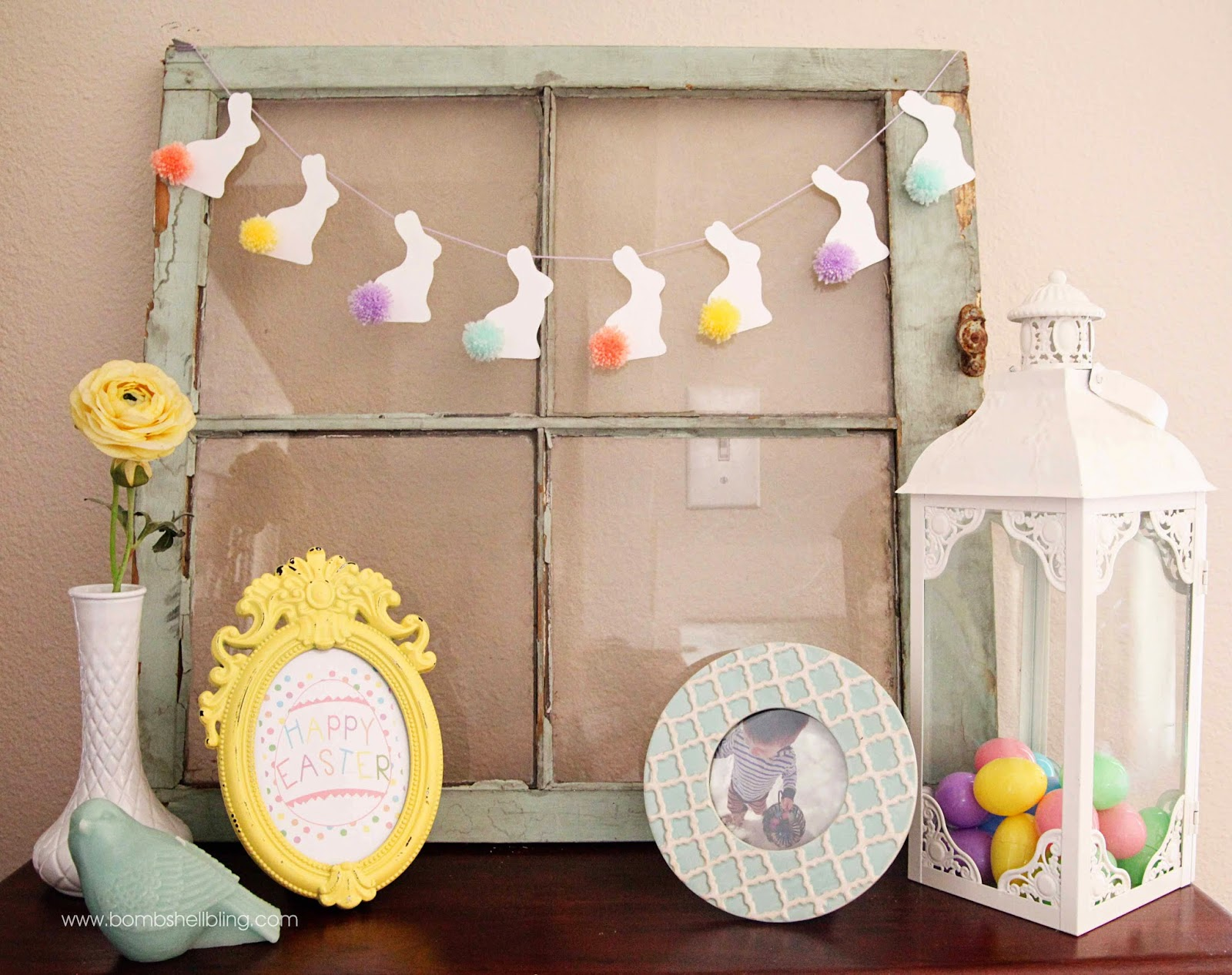 Make a darling pom pom bunny tail bunting for your Easter mantel! Sweet, unique decor to brighten your home during this Easter season.