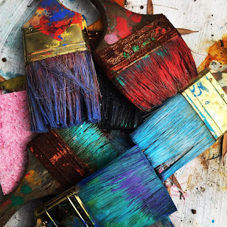 an image of colorful paint brushes