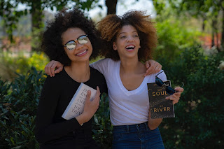 Two women and book.