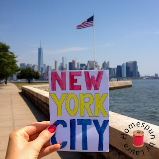 NYC watercolor painting with Manhattan skyline and American Flag, taken on Liberty Island