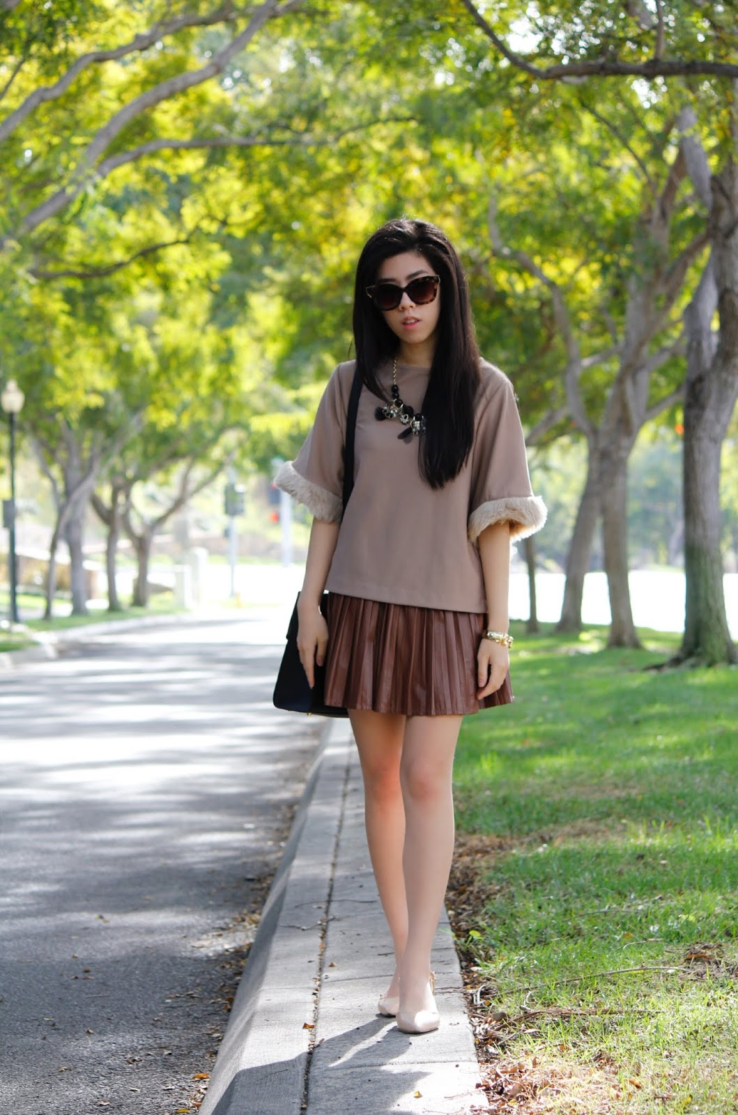 Adrienne Nguyen_How to Wear a Faux Fur Sleeve Top_ What to Wear with  pleated Leather Mini Skirt