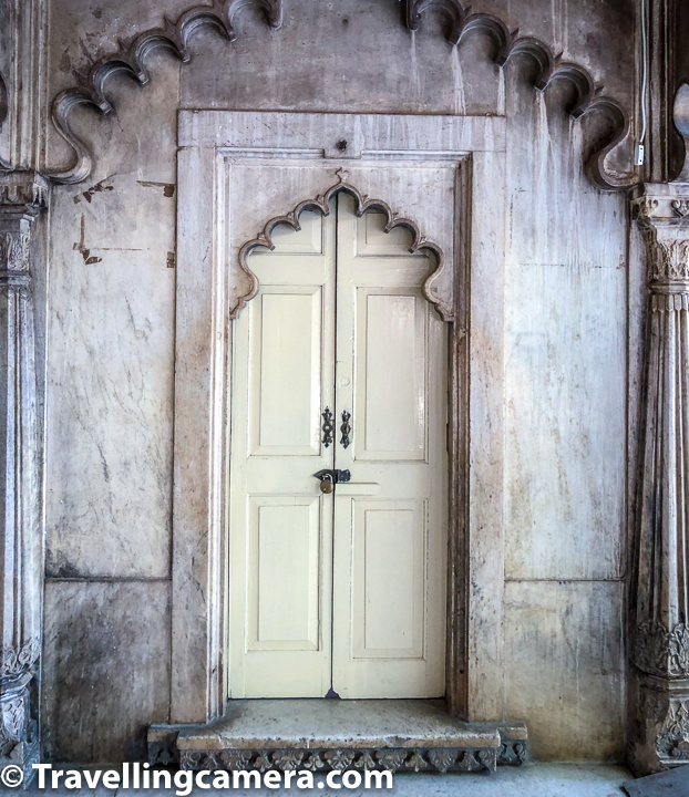 Not everything is open in the City Palace of Udaipur and that would be impossible to explore if everything is open. Above photograph shows a door with lock on it and it was clear that huge part of Udaipur City Palace was closed through this beautiful door. More than the wooden door, I liked architecture around it and the extended section indicating that there is a door ahead.