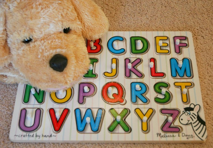 dog puppet and ABC puzzle