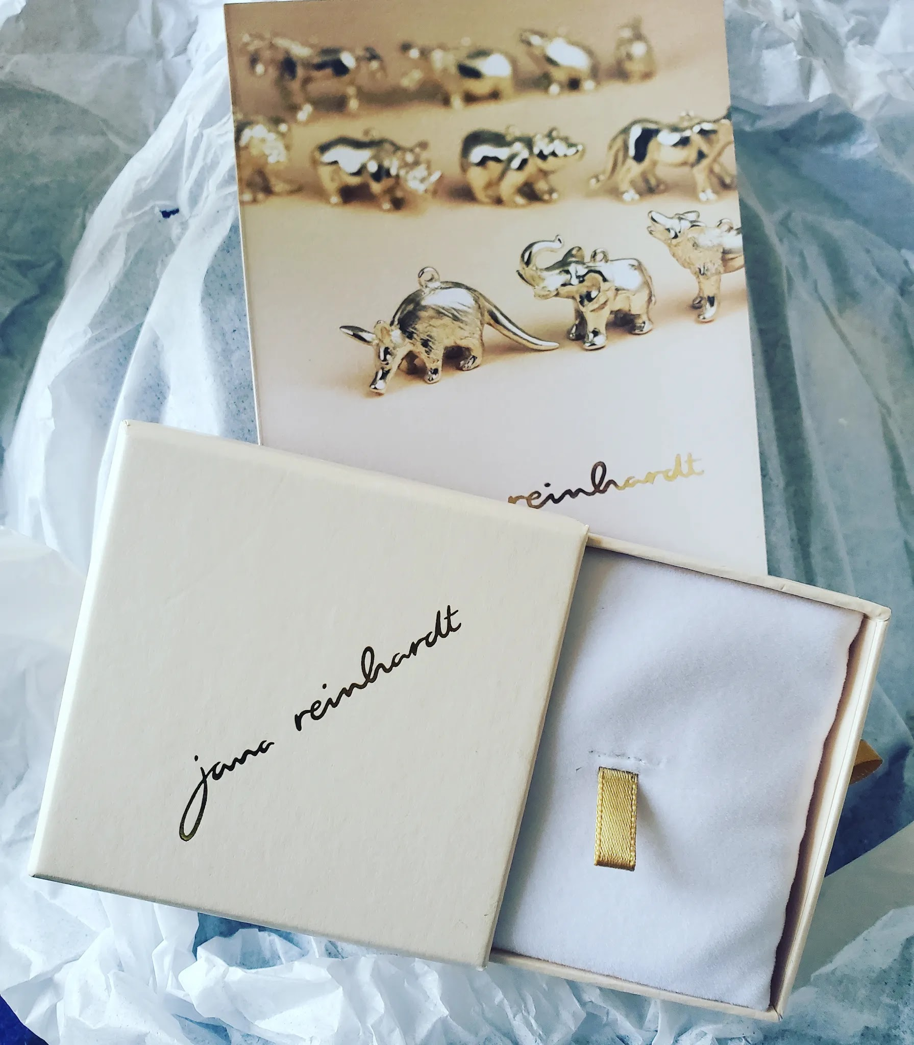 Jana Reinhardt ethical and sustainable jewellery unboxing with elegant white plastic free packaging