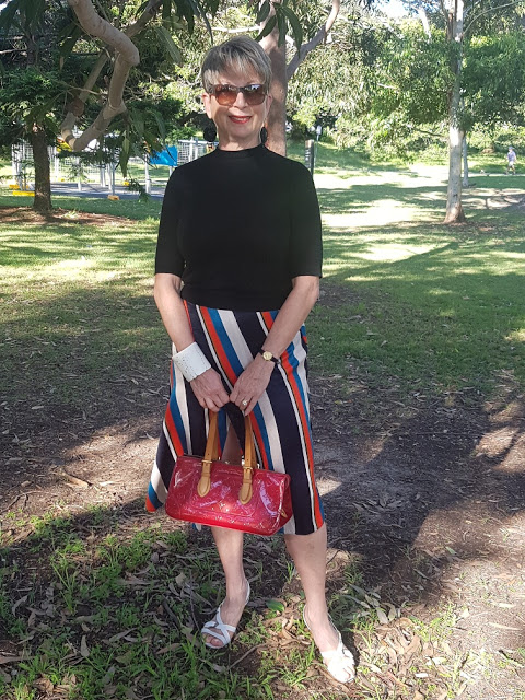 Black top and striped midi skirt for Is This Mutton readers favourite Anna Marcus from Fabulous at Fifty
