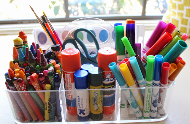 having paints and markers organized