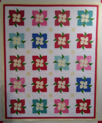 Patchwork quilt top composed of flower blocks