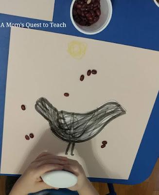 gluing dry beans onto clipart of bird