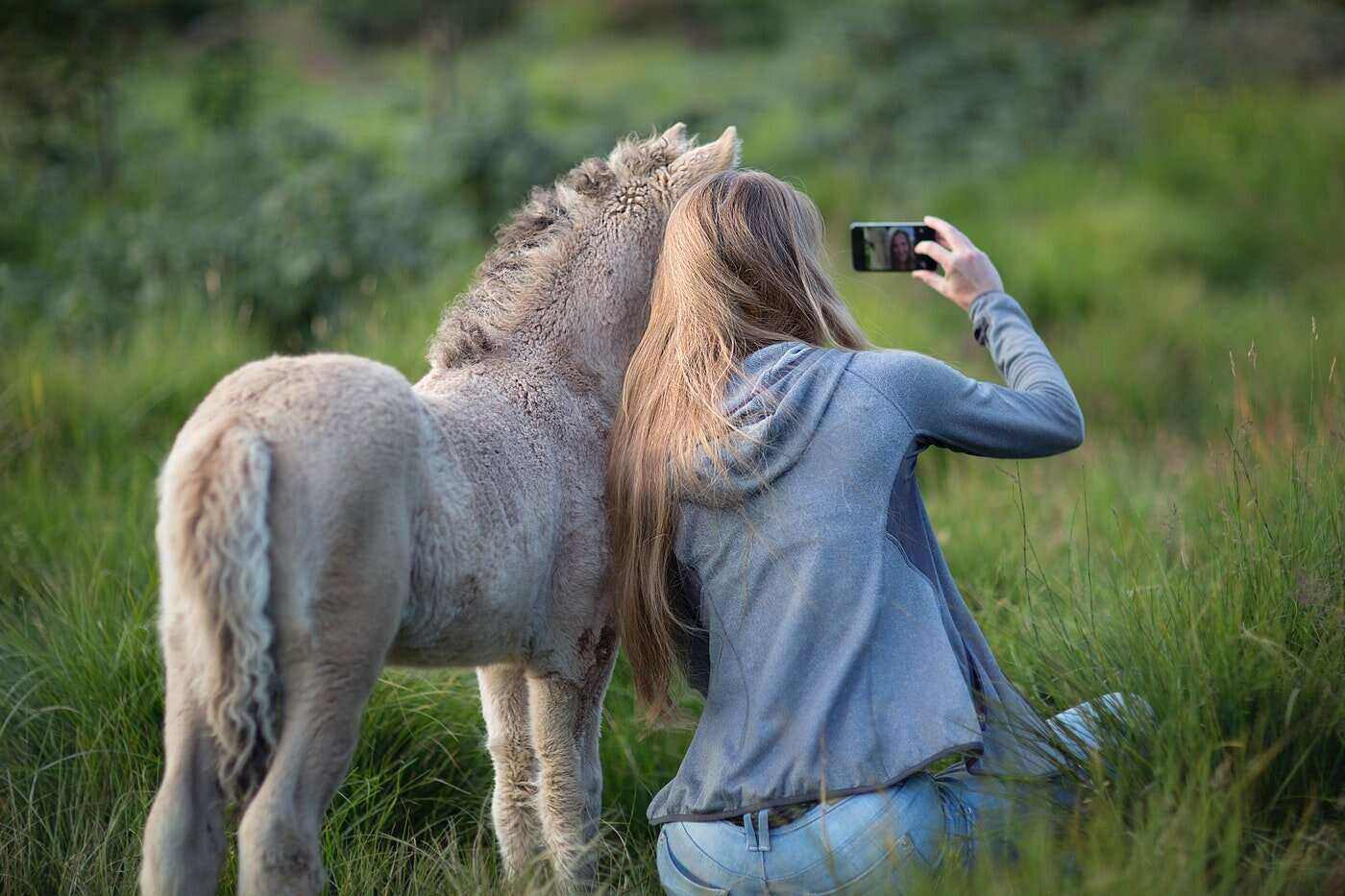 woman taking selfie with foal - 7 ways to memorialize your equine friend