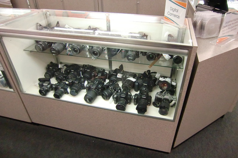 Cameras are placed in show case in Unclaimed Baggage Center