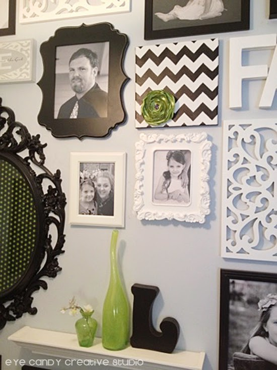 pictures on a photo gallery, black and white frames, lime green flower, green bottle