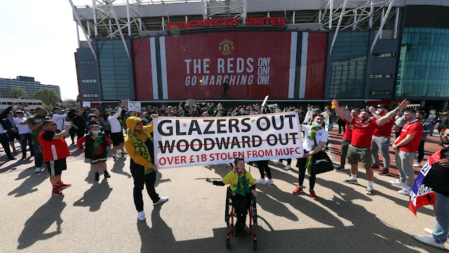 Man United fans hold Glazers out banner to protest before Man United vs Liverpool