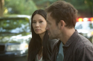 "Jonny Lee Miller as Sherlock Holmes and Lucy Liu as Joan Watson in Elementary Episode # 4 ""The Rat Race"""