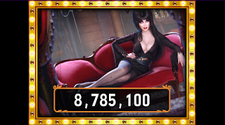 Big Win screen of Elvira Busting Out at Hit It Rich Slots