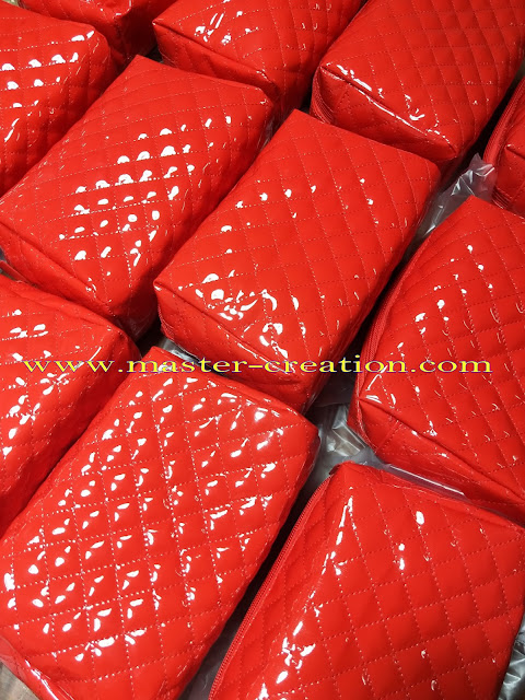 red glossy purse