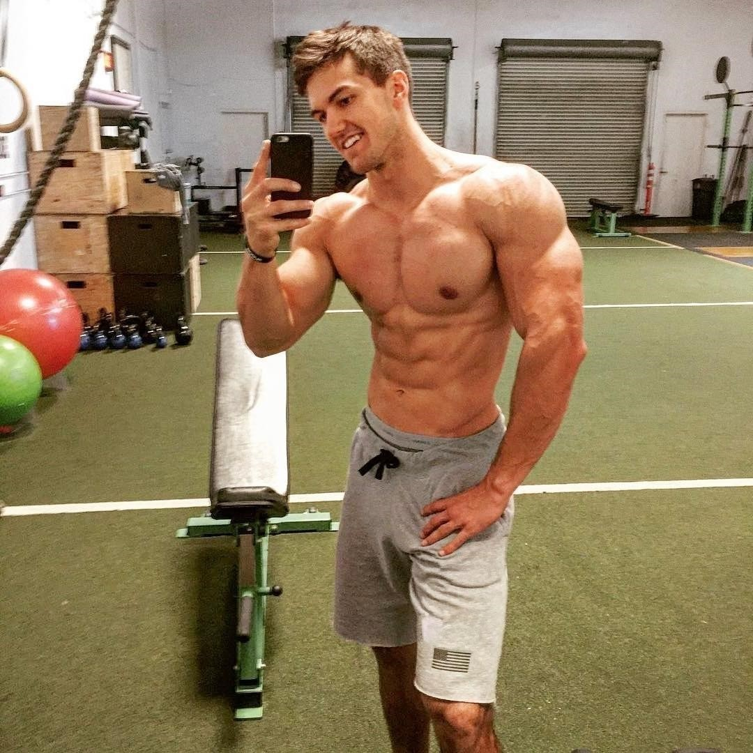 beautiful-faced-young-masculine-shirtless-gym-muscle-jock-smiling-selfie