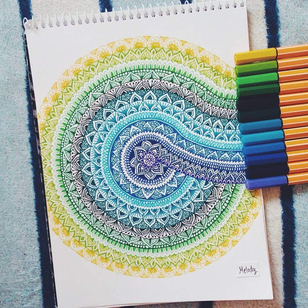 08-Mandala-Twist-Gyöngyi-Szabó-Bright-and-Colorful-Mandala-Drawings-www-designstack-co