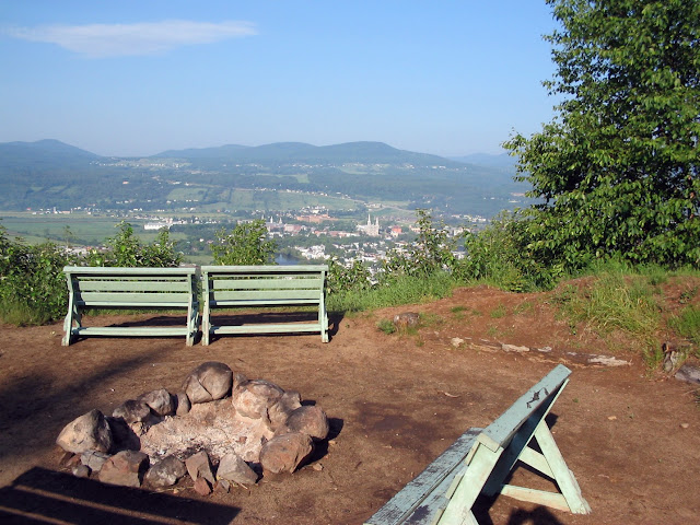 Firepit and benches with view of Baie-Saint-Paul, Québec, Canada