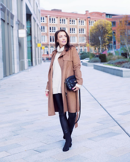 woman wearing brown trench coat