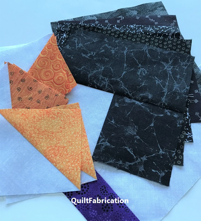 black fat quarter variety and oranges for sparkle for the Just Batty quilt