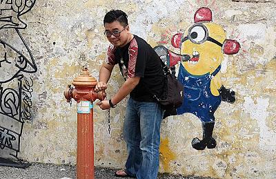 Karya mural di tembok dibeberapa bagian George Town, Penang