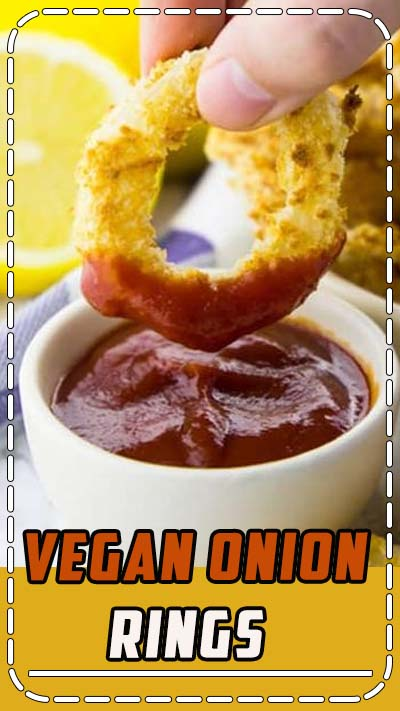 You are going to love these vegan onion rings! They are incredibly easy to make, crispy, and delicious. Plus, they are oven-baked, which makes them so much healthier than fried onion rings! Find more vegan recipes at veganheaven.org! #vegan #veganrecipes