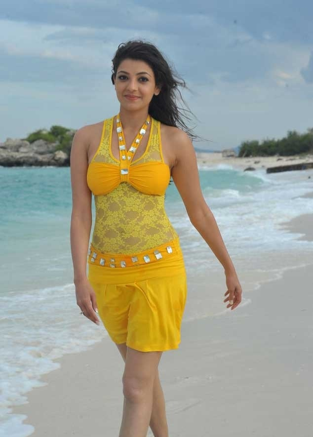 Kajal Agarwal Wet Sizzling Sleeveless Yellow Dress Stills In Beach