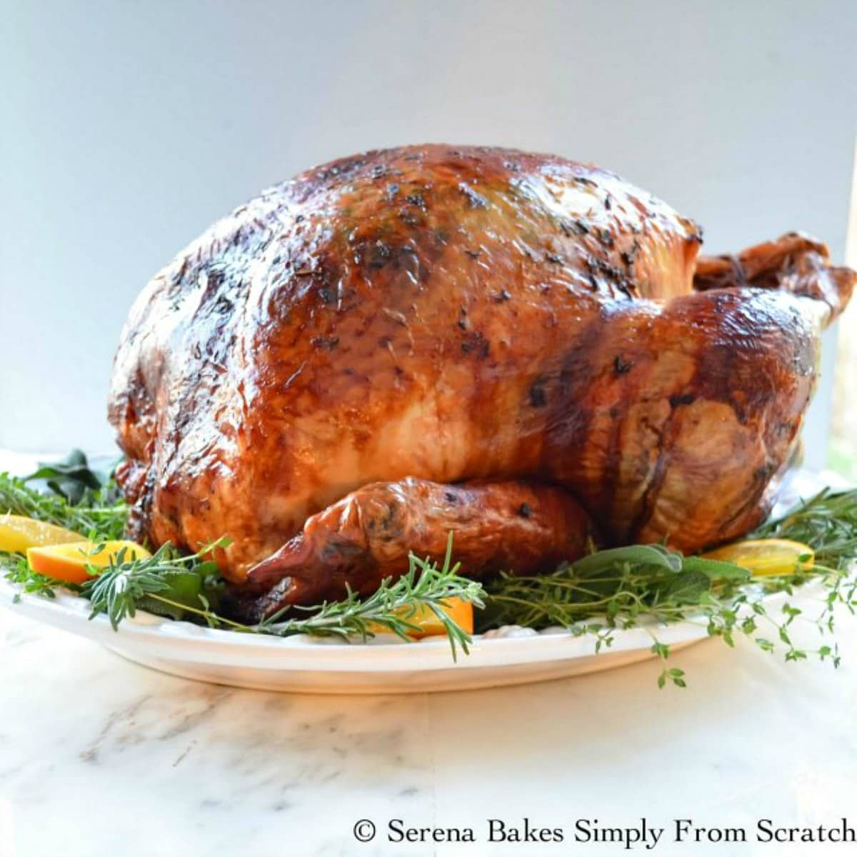 Super Moist and Juicy Turkey baked in cheesecloth and seasoned with herb butter is a Thanksgiving must make! The flavors amazing from Serena Bakes Simply From Scratch.