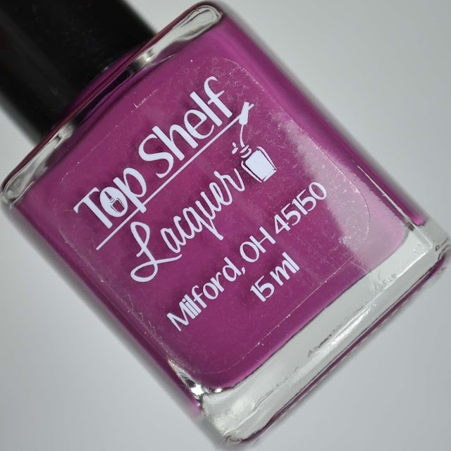 purple nail polish in a bottle