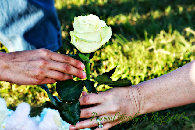 woman handing a woman a white rose | nfant loss | rosevinecottagegirls.com