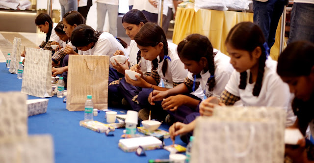 Swarovski brings smile to 100 underprivileged children Swarovski joins hands with Smile Foundation