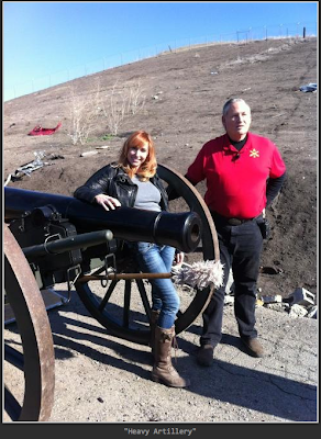 Kari Byron posing with a cannon before a cannonball accident