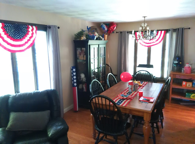 Americana dining room with red, white, and blue holiday party decorations.