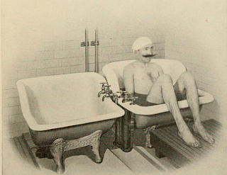 man sitting in a bathtub made only for your hips