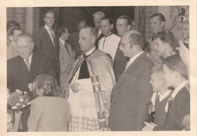 Konrad Adenauer (at left, behind the children) visiting St. Ludwig's Catholic Church in Wilmersdorf, Berlin in July 1954. Pfarrer Greve is pictured along with Josef Jakobs' son, Raymond Jakobs (wearing the dark suit just behind and to the right of Adenauer) (postcard photo from Jakobs family collection)