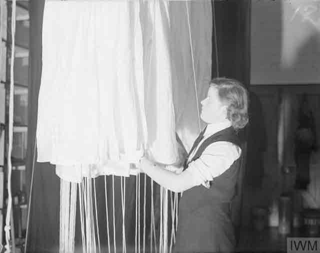 Wren packing a parachute, 17 November 1941 worldwartwo.filminspector.com