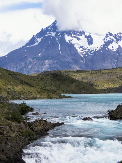 Salto Chico waterfall with mountain backdrop at Torres del Paine National Park in Chile