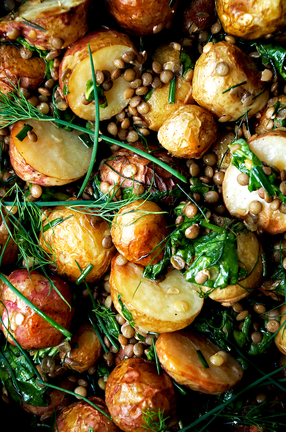 This roasted potato salad with lentils and a herby dressing is a far cry from standard mayo-filled potato salad - it's very light and a meal in itself with protein-packed lentils and spinach. The herb vinaigrette lifts everything up here, with dill, chives, and a little spicy mustard - perfect for picnics and barbecues.